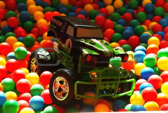 Car in playing balls