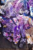 Colourful transparent plastic shoes in a Thai open air market