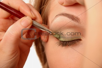 applying eye make-up