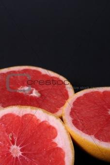 Three slices of grapefruit