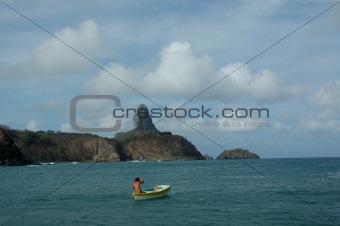 Fisherman in smal boat