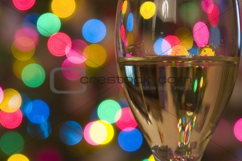 Close up on a Wine Glass with the lights on the background
