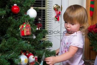 Baby at christmas tree