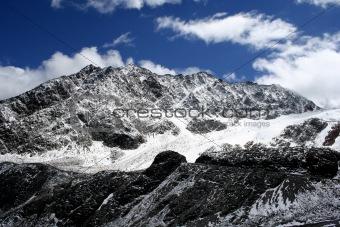 Black mountain - blue sky