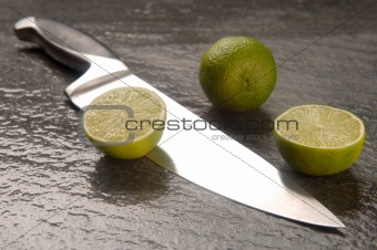 Lime fruits &amp; chef&#39;s knife