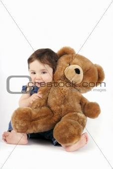 Baby Girl hugging her teddy