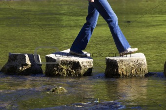 crossing three stepping stones in a river,