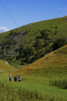 Group of people walking in hills