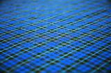 blue checkered celtic fabric textured background. shallow DOF.