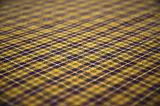 checkered celtic fabric textured background. shallow DOF.