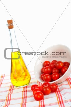 Olive oil bottle and tomatos cherry