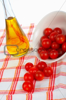 Oil bottle and tomatos cherry