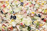 mixed salad with white dressing. suitable for background