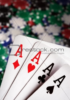 aces and  Casino Chips in background