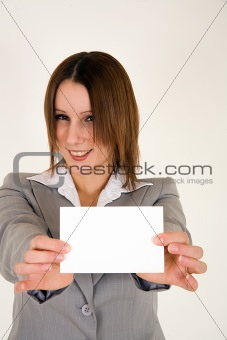 Business woman with extended card