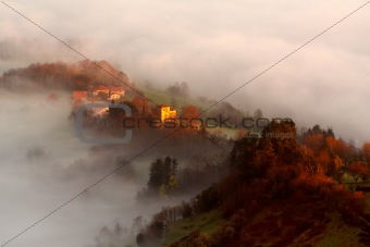 Houses between the fog
