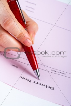 Writing blank delivery note with pen