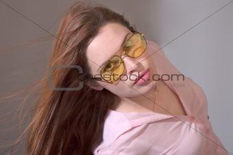 Brunette in yellow sun glasses