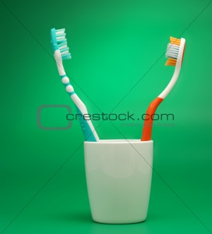 Tooth-brush green background