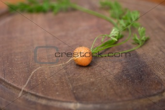 baby carrot on a chopping board