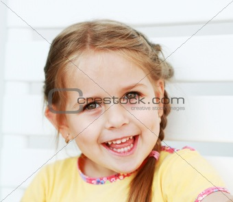 Cute kid laughing sincerely