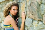 Fashion portrait against stone wall