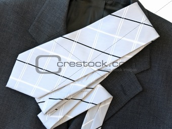 grey suit and white tie at the table