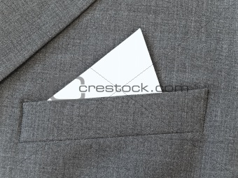 Close up suit pocket with white handkerchief
