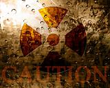 Worn nuclear sign with caution note