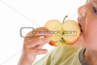 Boy biting an apple slice