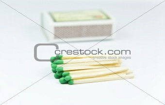 Green wooden matches over box