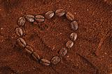 coffee beans in heart shape and ground background