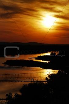 Beautiful setting sun on river surface