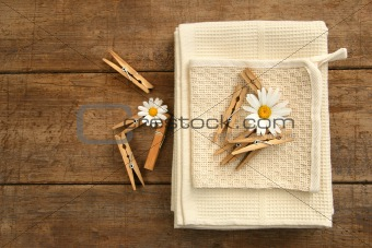 Close-pins and dish towels on old table 