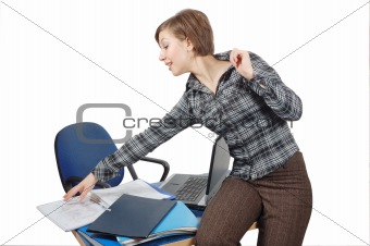 attractive girl on workplace reach for folder