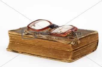 broken eyeglasses and book
