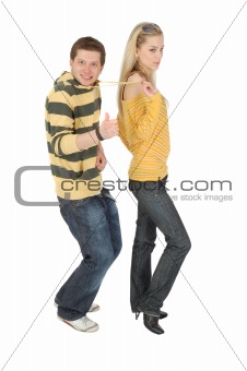 serious girl pull funny boy by lace on clothes