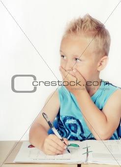 Little boy doing math homework