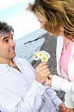 Mature romantic couple with flowers