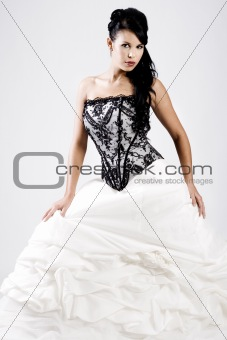 Young bride in black and white wedding dress