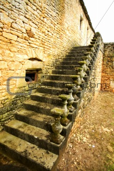 Old Stone Ladder with the destroyed handrail,  small village in