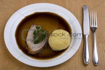 bavarian roast pork dish with potato dumpling