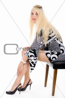 Sitting woman in black and white dress