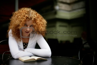 Smart girl reading a book