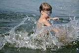 boy splashing in water