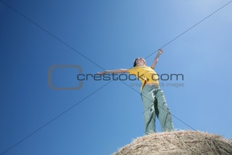 Boy on haystack