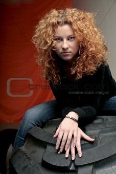 Attractive redhead on tire