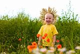 child in the field of poppies