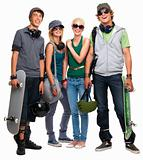 Young boys and girls standing with skateboard and helmet