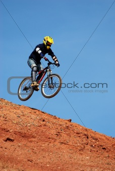 Fly mountain biker